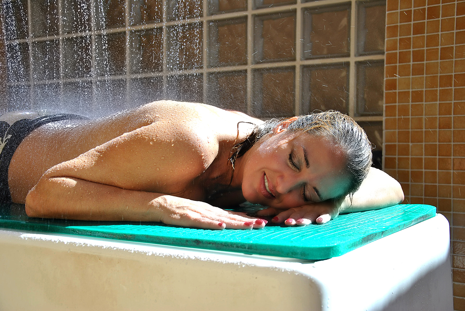 woman in a water treatment at a spa